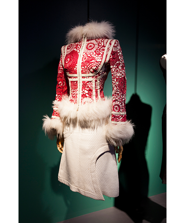 """It's grouped together by thematic sections. The first looks at the fragility of the garments and what stains, holes, wears and tears can tell you about this woman. Another sections looks at the way in which she nurtured talent, her love of history and inspiring designers like McQueen and Philip Treacy.""<p>Jacket by Alexander McQueen 2003, skirt by Alexander McQueen 2003&nbsp;</p>"