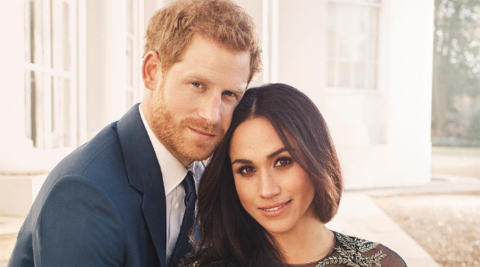 Meghan Markle and Prince Harry release loved-up engagement photos